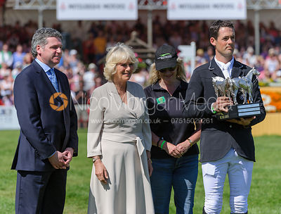 Jonathan Paget receives the Badminton trophy - show jumping phase,  Mitsubishi Motors Badminton Horse Trials, 6th May 2013.