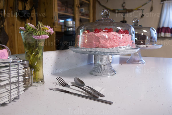 Homemade cherry cake on a cakeplate in an old roadside diner