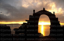 Stone arch at sunset, Taquile Island, Peru