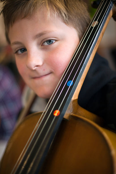 UK - Scunthorpe - A boy, part of the Youth Concert Band practices his cello during rehearsals of Cycle Song at the John Leggo...