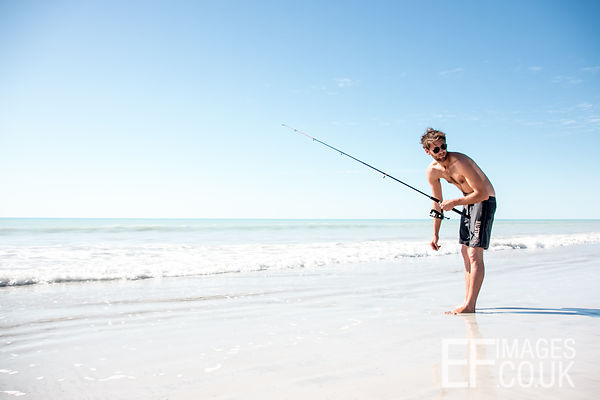 Man Fishing On A Tropical Beach