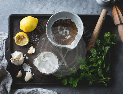 Ingredients for spiced garlic yogurt dip with mint.