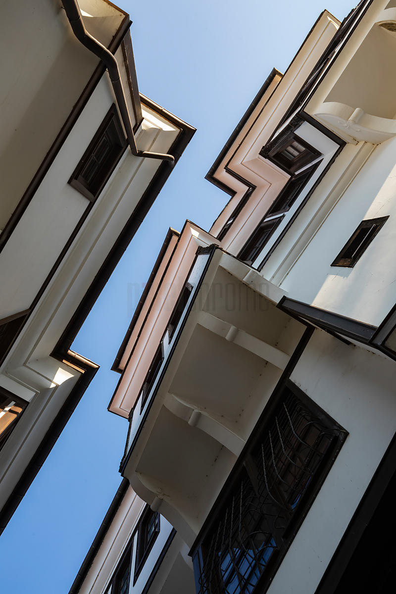 Looking up at Buildings in a Narrow Street