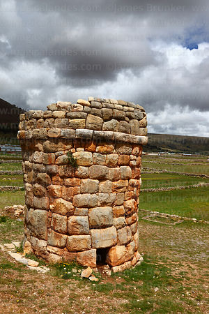 Round fieldstone chulpa or burial tower (probably Inca) at Molloko, near Acora, Peru