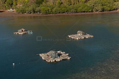 Aerial view of grow-out fish pens at fish farm in which line caught fish are grown on for the Live reef fish trade for export...