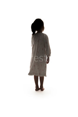 Silhouette of a little barefoot girl in a night dress – shot from mid level.