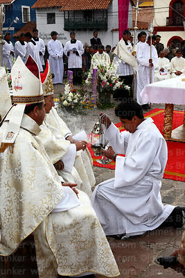 Bishop of Puno Jorge Carrion Pablisch putting incense into silver incense burner at start of central mass, Virgen de la Cande...