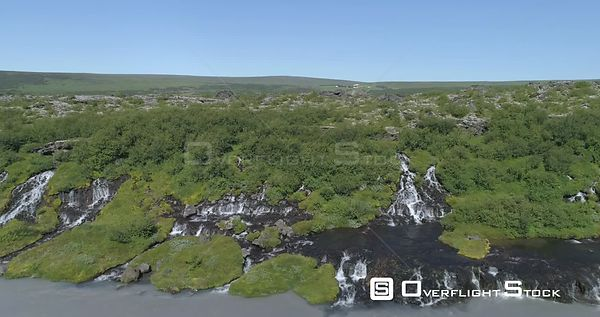 Flying Diagonally Over Hraunfoss Lava Spring Waterfall Glacial River Iceland Aerial 4k