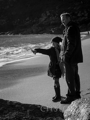 child pointing on Porthcurno Beach