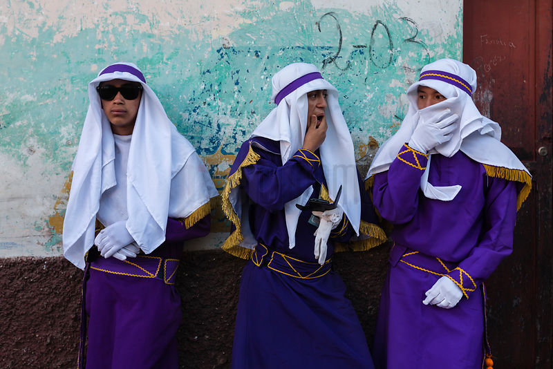 Portrait of Three Penitents Watching Semana Santa Parade