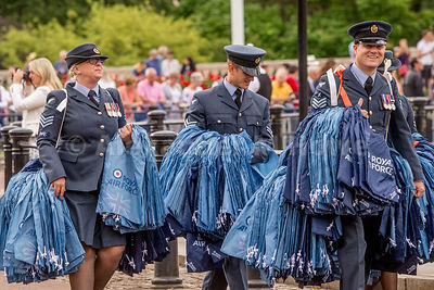 RAF air men and women carrying RAF bag and flag giveaways