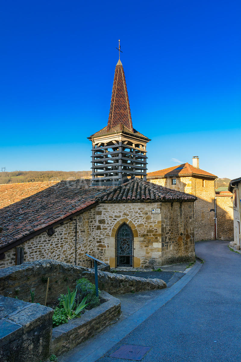 Church and small road of the village of Chatillon d Azergues