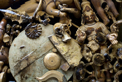 India - Swamimalai - Disgarded wax moulds lie in a tank of water in the  workshops of the Stpathy family of bronze statue makers