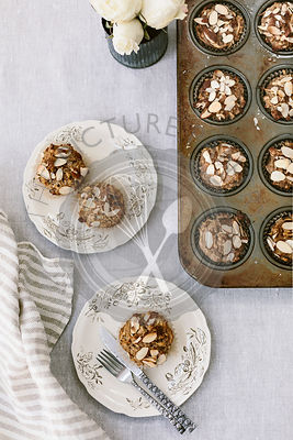 Freshly baked Parsnip Morning Glory Bran Muffins are photographed from the top view.