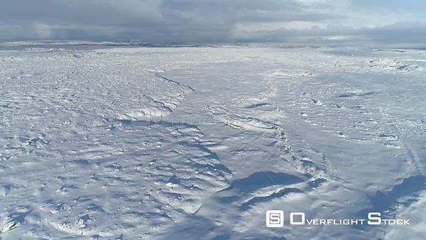 High Aerial Revealing Shot of Expansive Snowy Lava Field Iceland Day