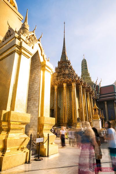 Thailand, Bangkok. Temple of emerald Buddha with tourists