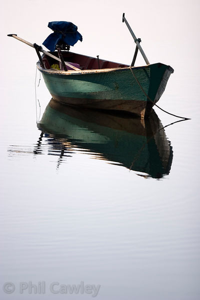 A small boat moored in calm water