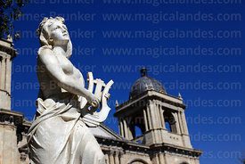 Statue representing music and cathedral tower, Plaza Murillo, La Paz, Bolivia
