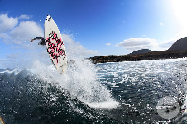 "Watershot of David  ""Don't f&@# wtih Chuck""  Jaio launching a nice frontside  360 on a wave, La Graciosa island, Canary islan..."