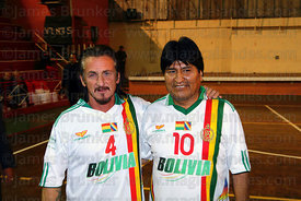 American actor Sean Penn and Bolivian president Evo Morales wearing Bolivian national football shirts at a futsal tournament,...