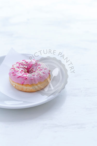 Pink Doughnut, just one  on a white plate