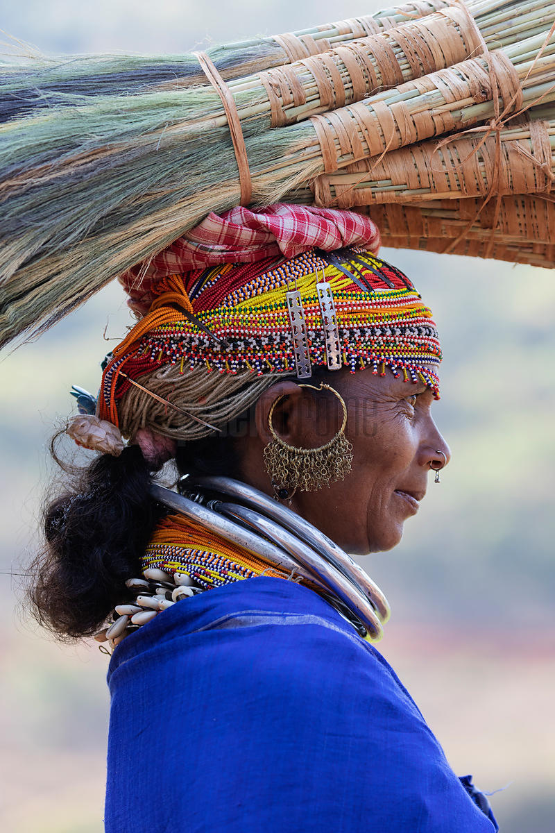 Portrait of a Woman from the Bonda Tribe Carrying Brooms to  a Local Market