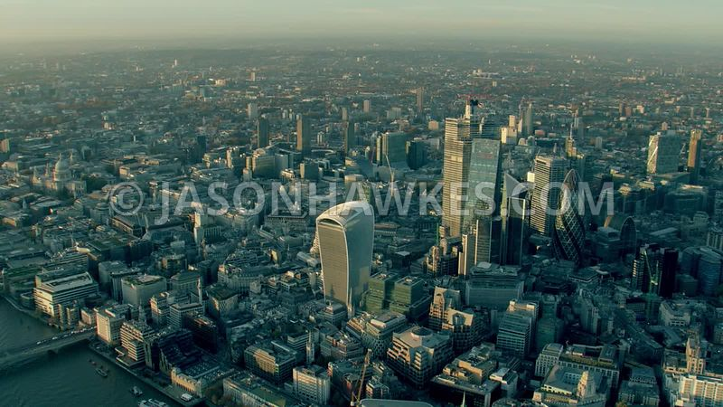 Aerial footage of the City of London at sunset.
