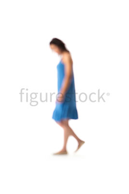 A blurred woman in a blue dress, walking – shot from mid level.