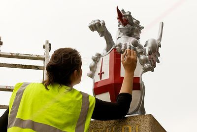 City of London Painter working on the Dragon Statues by London Bridge