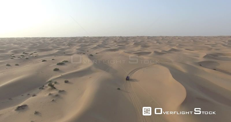 Drone Video of a Jeep Driving through Sand Dunes Dubai