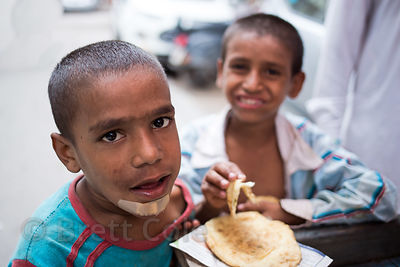Boys who spend each day on the street eat at an NGO (charity) in the Paharganj area of Delhi, India