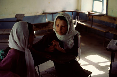 Two schoolgirls in a classroom in Mazar-i-Sharif, Afghanistan