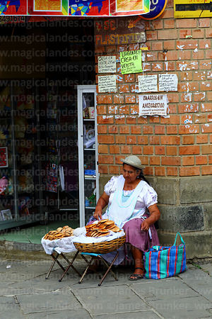 Woman selling empanadas on street stall outside shop, Tarija, Bolivia