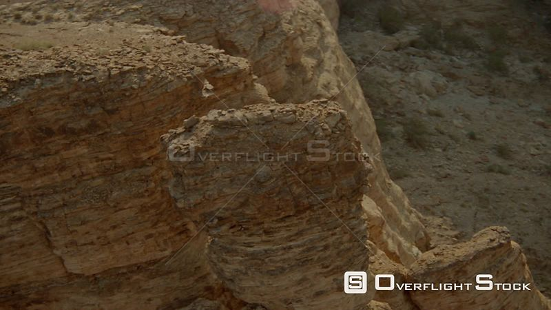 Aerial close up along mountain top of rocky formations, pass gap, wide shot over top to mountain range in background Fish Riv...