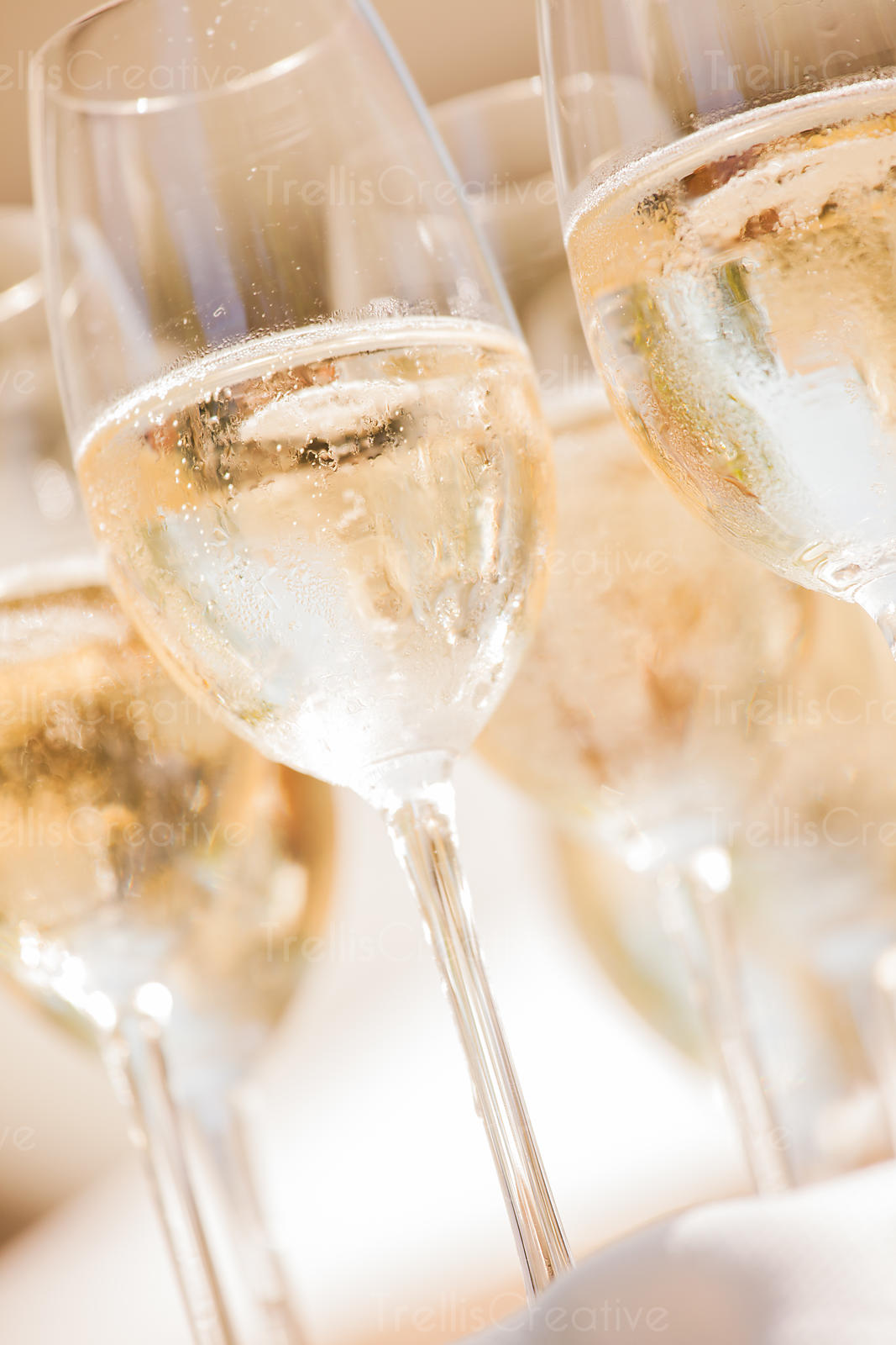 Close up photo of flutes of chilled champagne glasses