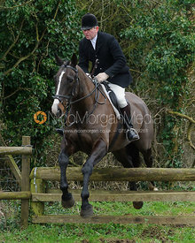 Tim Hercock jumping a hunt jump near Knossington Spinney