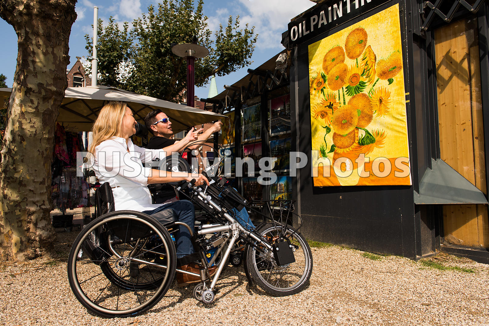 Couple using power wheelchairs at an art fair