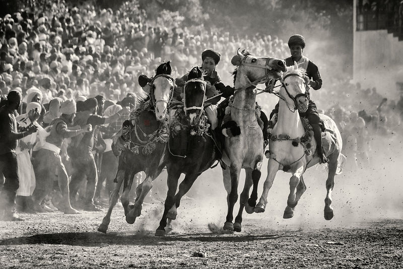 Nihang Sikh Warriors Show off their Riding Skills During the Horse Games at the Annual Holla Mohalla
