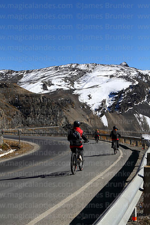 "Mountain bikers below La Cumbre at start of ""The Worlds Most Dangerous Road"", Bolivia"