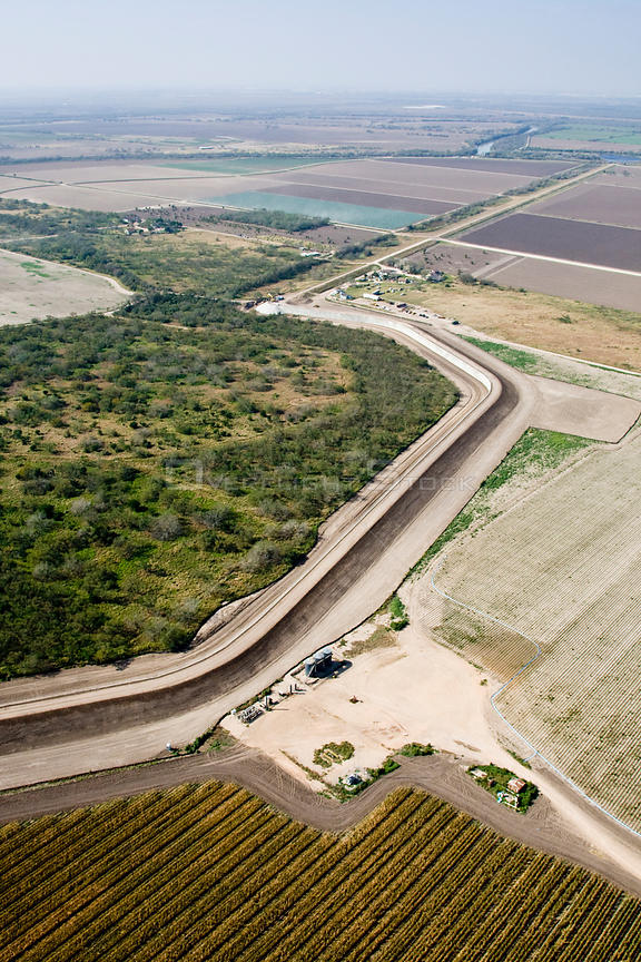 Aerial view of the US / Mexico border wall in Hidalgo County showing how wildlife corridors are severed, reduced or eliminate...