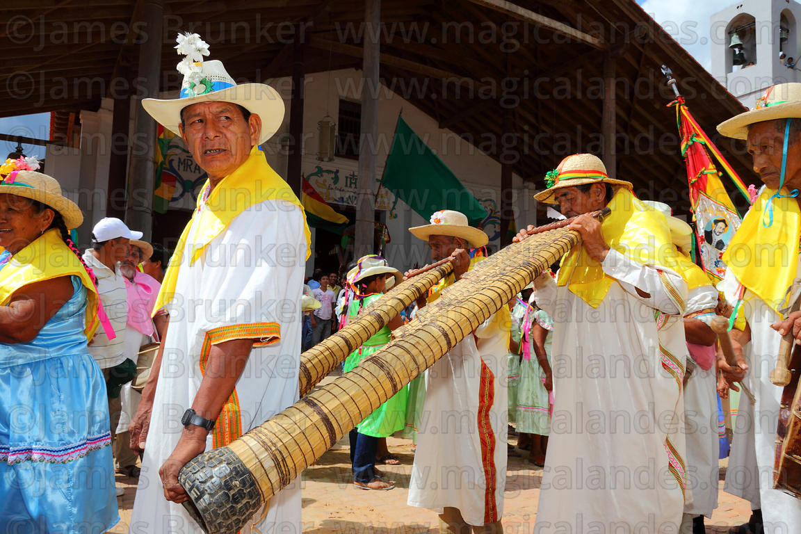 Musicians playing Bajon Grande in front of church during main procession, San Ignacio de Moxos, Bolivia