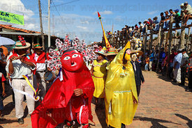 Dancers wearing sun and moon costumes during main procession of festival , San Ignacio de Moxos, Bolivia