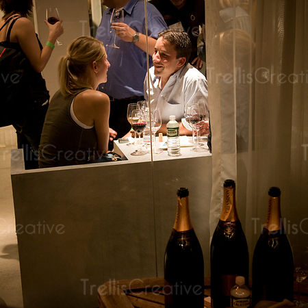 A couple sits at a table drinking wine