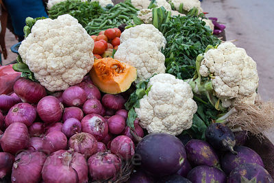 Cauliflower, onions, and eggplant at a market stall in Varanasi, India.
