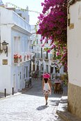 Woman walking in the streets of Tarifa, Andalusia, Spain