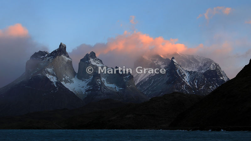 Looking north to the Paine Massif from Hosteria Pehoe at sunrise, Torres del Paine National Park, Patagonia, Region XII Magal...