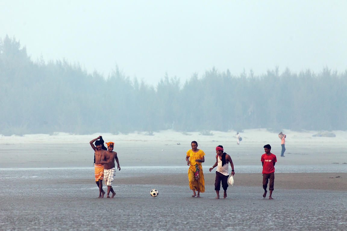 People play soccer on the beach during the Gangasagar Mela, Sagar Island, India.