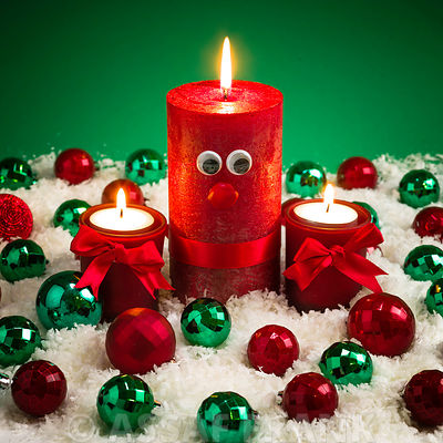 Red christmas candles with eyes and baubles