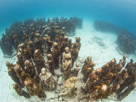 Part of 450 life-0sized underwater sculptures installed in 2009-2012 by Jason deCairesTaylor in 8m/23Ft on Manchones Reef nea...