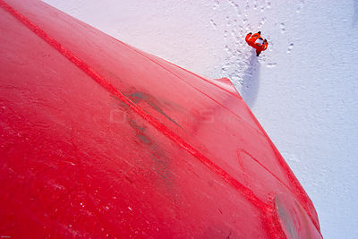 Crew member of the US coastguard ship 'Healy' standing on the sea ice in front of the ship's hull after the ship became stuck...